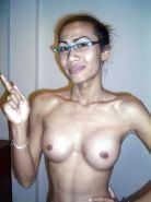 Nun - Thai Ladyboy with long cock and tits