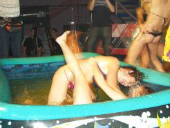 Party girls 'fighting' in paddling pool