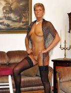 MILF posing in black stockings