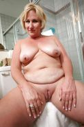 Chubby Blonde Milf puttin lotion on her skin....