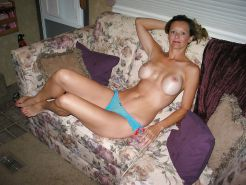 Amateur MILF with silicone enhanced tits!