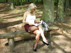 Blonde shows her legs in stockings 4