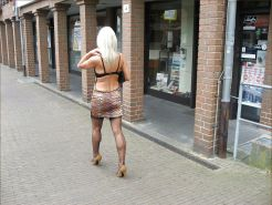 Blonde shows her legs in stockings 6
