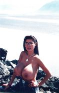 Huge-titted asian girl showing them off in Alaska