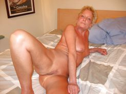 Shaved Granny with Toys on Bed