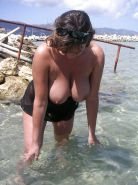 BUSTY MILF ON THE BEACH