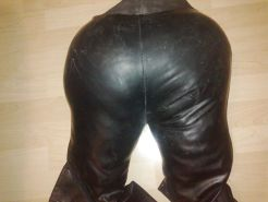 Sister's black leather ass fucking