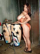 Brunette Chloe posing her big boobs with drums