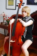Pretty blond german with blue eyes and a Cello