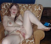 Redhead fingering and fondling herself