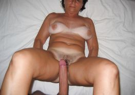 Hairy Mature Riding a large cock