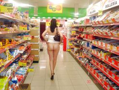 Beautiful girls nude in public in a shop
