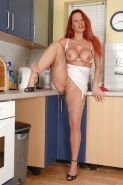 Busty milf Faye in the kitchen