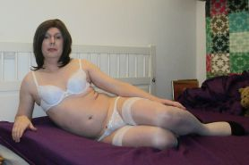 TS Emma Lee on her bridal bed in white lingerie