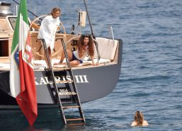 Bar Refaeli relaxes in a tiny bikini on a yacht in Cannes