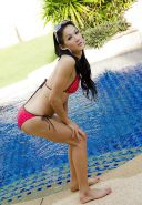 Beautiful asian shemale in swimming pool