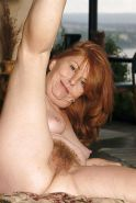 Hairy granny redhead showing her goods