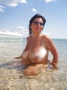 Amateur mature possing naked outdoors on the beach