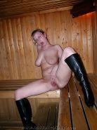 Redhead teen with boots in sauna