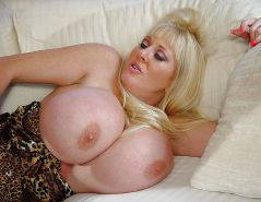Mature blondie with big hooters rides a stud