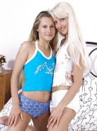 Hot blonde lesbians and a strap-on in bed together