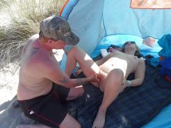 Fingering woman on beach
