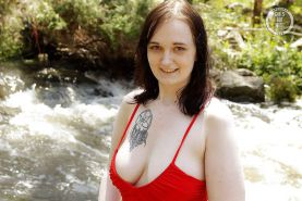 Amateur girl Rubie toys her hairy pussy by the river
