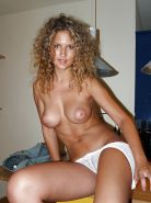Curly hair and puffy nipples - N. C.
