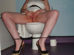 My milf on toilet playing with her pussy