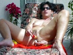 Horney mature milf masturbating on the balcony