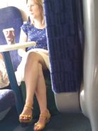 Milf shows legs and upskirt on train