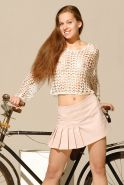 Brunette model posing with a bicycle