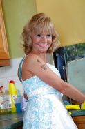 Housewife gets naked in the kitchen
