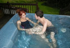 Couple fuck in jacuzzi in a swimsuit
