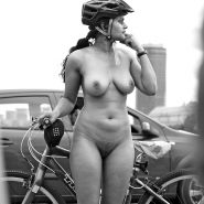 Naked cycling in public.