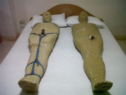 Bondage Slaves - Mummification. Who wants to wrap me?