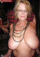 Mardi Gras busty granny! Does Anyone know her name?