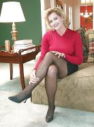 Mature American business lady at home
