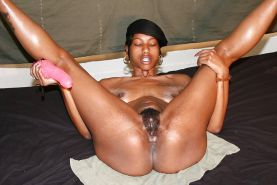 African Ghetto Slut Playing with Her Hairy Pussy