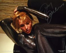 LUCY LAWLESS  -- SEXY IN CATSUIT