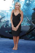 Emily Osment - Busts Out For Disneys Maleficent