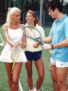 Two guys and two gals having fun on the tennis court