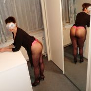 Upskirt in pantyhose in front of the mirror - High Heels