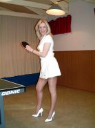 Mature leggy lady plays table tennis