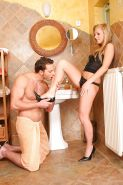 Blonde chick Barbie White having her lovely legs and feet attended to