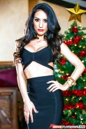 Brunette chick Tia Cyrus revealing big tits in stockings by X-mas tree