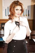 Sultry redhead babe undressing and exposing her goods on her office desk