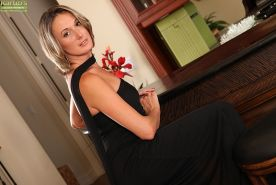 Pretty over 30 MILF Misty Law models non nude in black dress and high heels