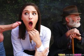 Long sock clad teen pornstar Abella Danger blowing big cock in public