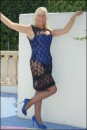 Plump mature blonde Sandy Spain posing in high heels and stockings outdoor